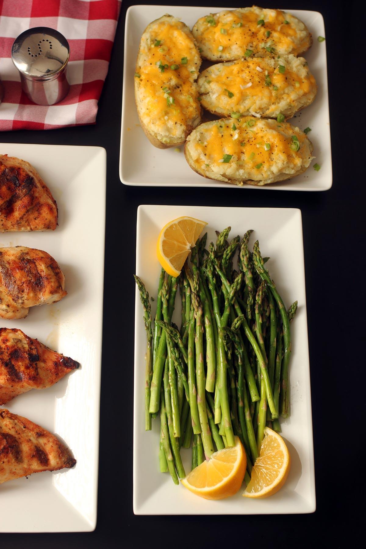 dinner table set with asparagus platter