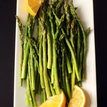 platter of asparagus with lemon