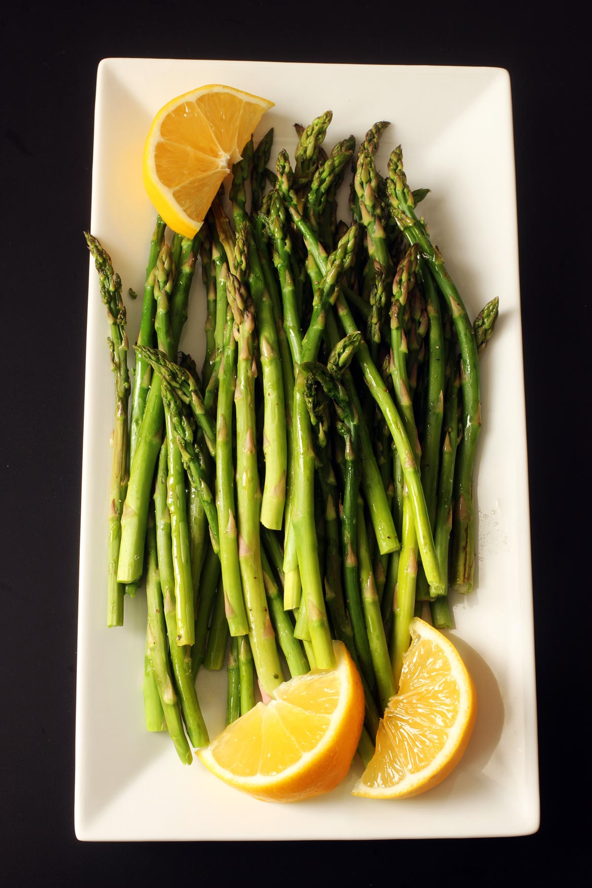 platter of asparagus with lemon