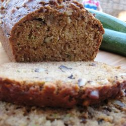 A close up of a piece of zucchini bread on cutting board