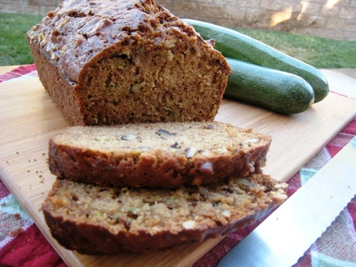 A loaf of zucchini bread on a board