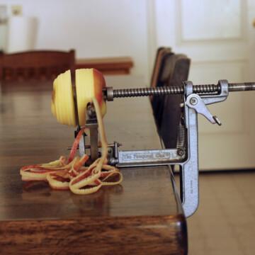 apple on apple slicer with peels