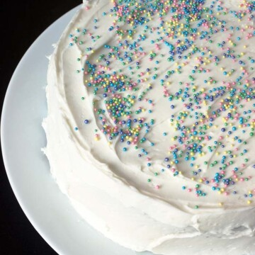 sprinkled white layer cake on white platter