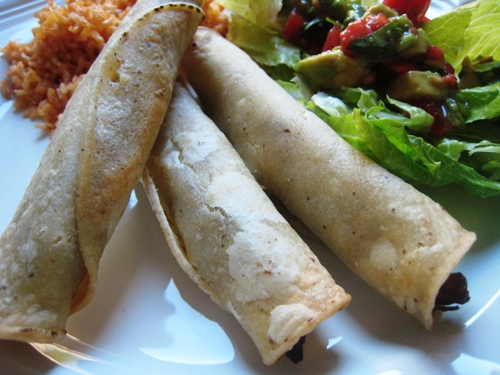 A plate of taquitos