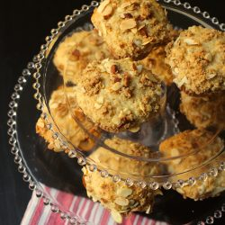 apple muffins with streusel top on cake stands