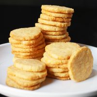 stack of cheddar cracker coins on white plate