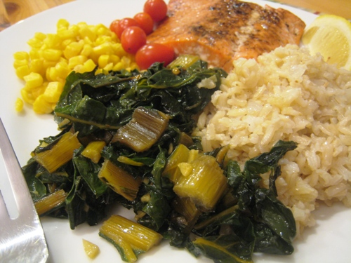 A plate of food with chard and vegetables