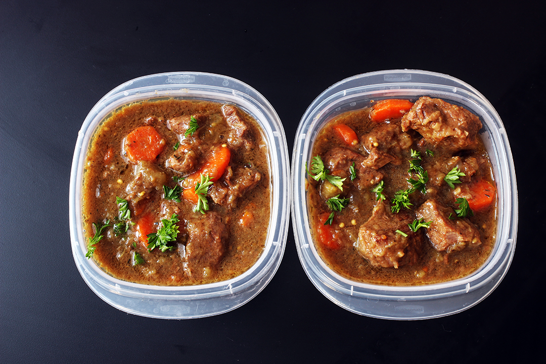 plastic containers of eggplant beef stew