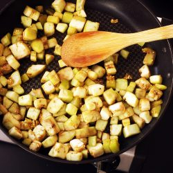 sauteeing eggplant cubes in skillet