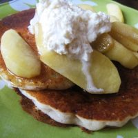 apples and whipped butter on stack of pancakes