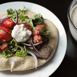 A plate of grilled steak gyro