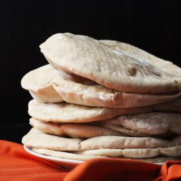 a stack of pita breads