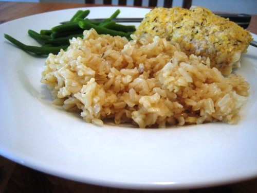 A plate of food with rice and green beans