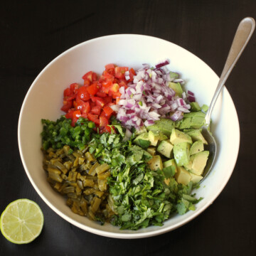 bowl of cactus with salsa ingredients unmixed