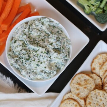healthy spinach dip with veggies and crackers