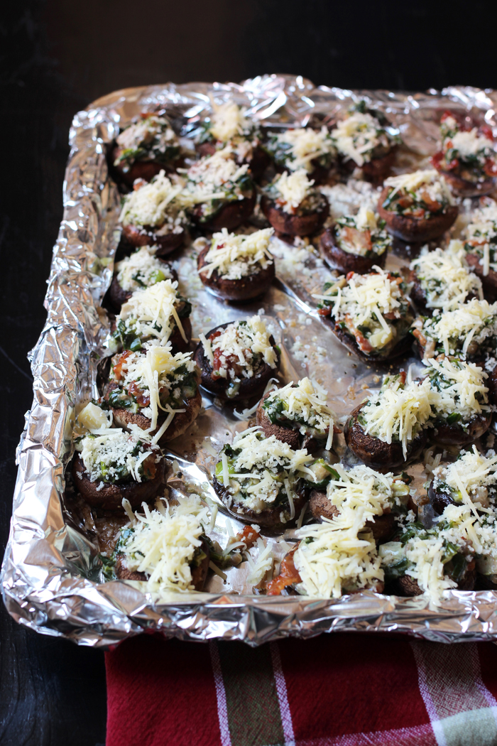 lined tray with stuffed mushrooms ready to broil