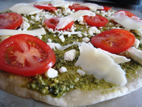 pizza made on a tortilla, with tomato and pesto