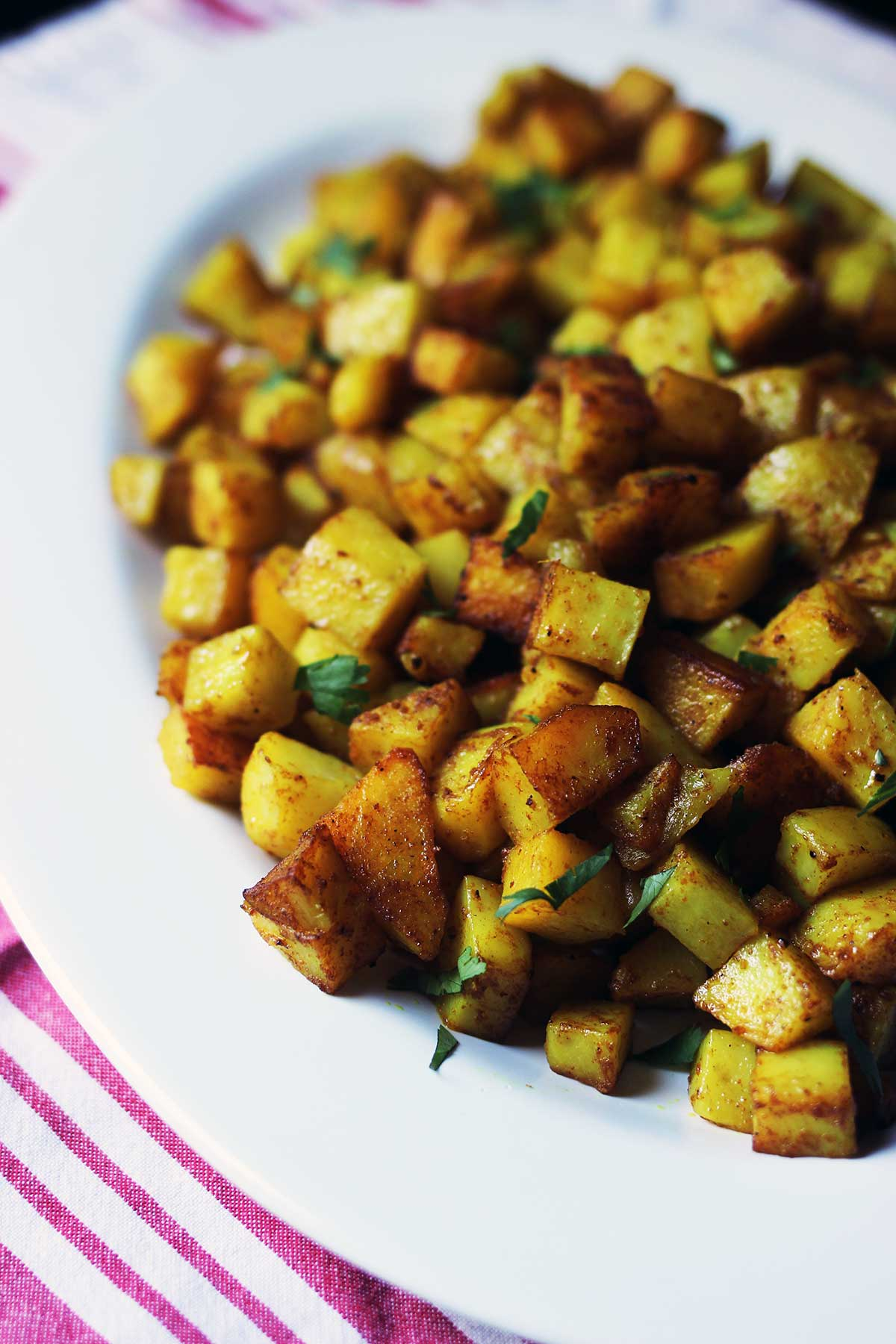 close up of curried potatoes in dish