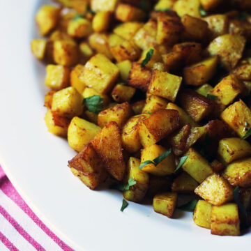 close up of curried potatoes on platter