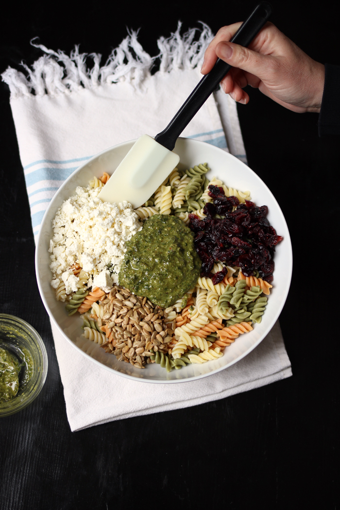 bowl of pesto cranberry pasta salad