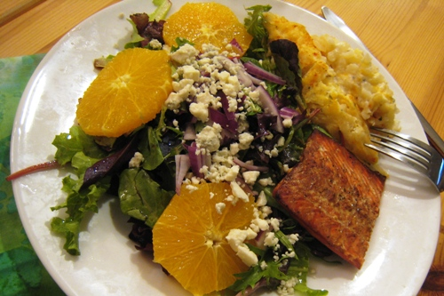 A plate of salmon and salad