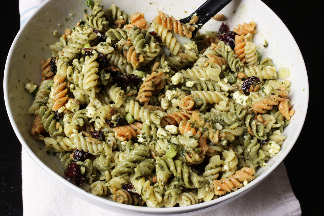 white bowl of Pesto Cranberry Pasta salad
