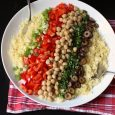 ingredients layered over couscous for salad