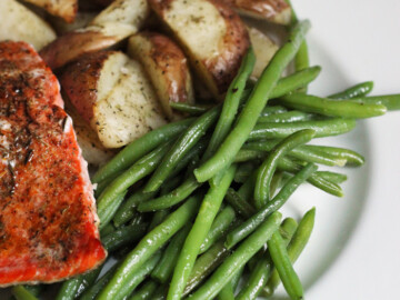 A plate of green beans, potatoes, and salmon