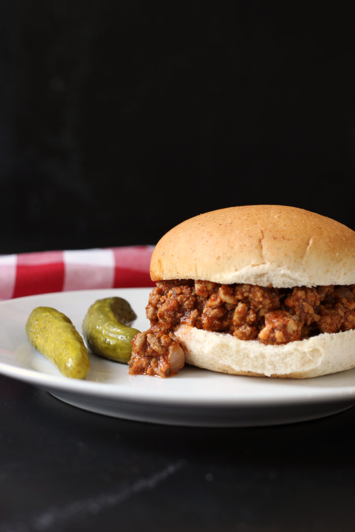 A close up of a sloppy joe on a plate