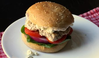 turkey burger on plate with blue cheese crumbles