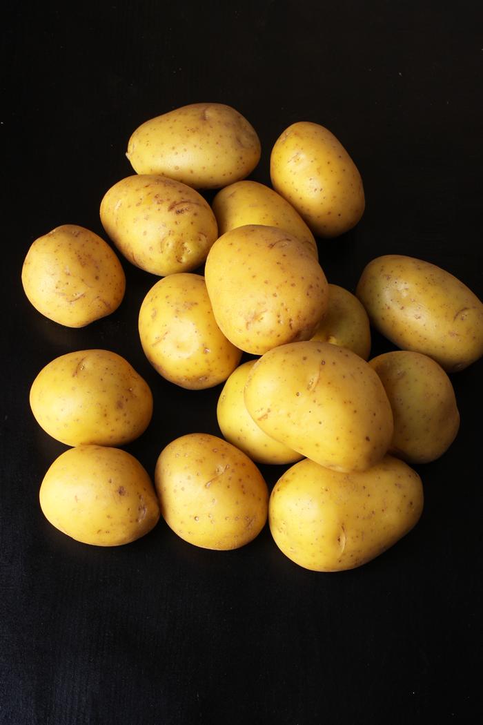 pile of yukon gold potatoes