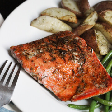 A plate of salmon and potatoes