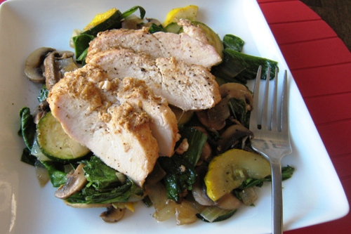 A plate of chicken with sautéed yu choy