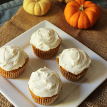 cupcakes on platter next to pumpkins