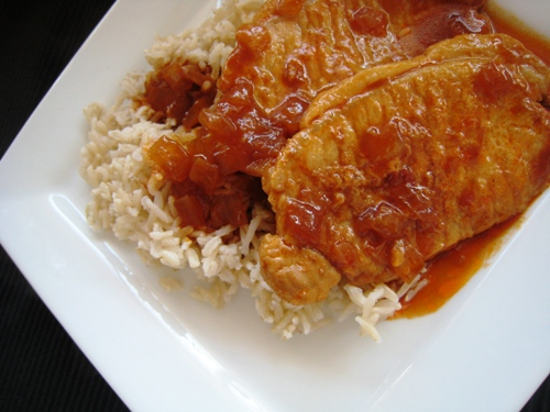 A plate of skillet pork chops and rice