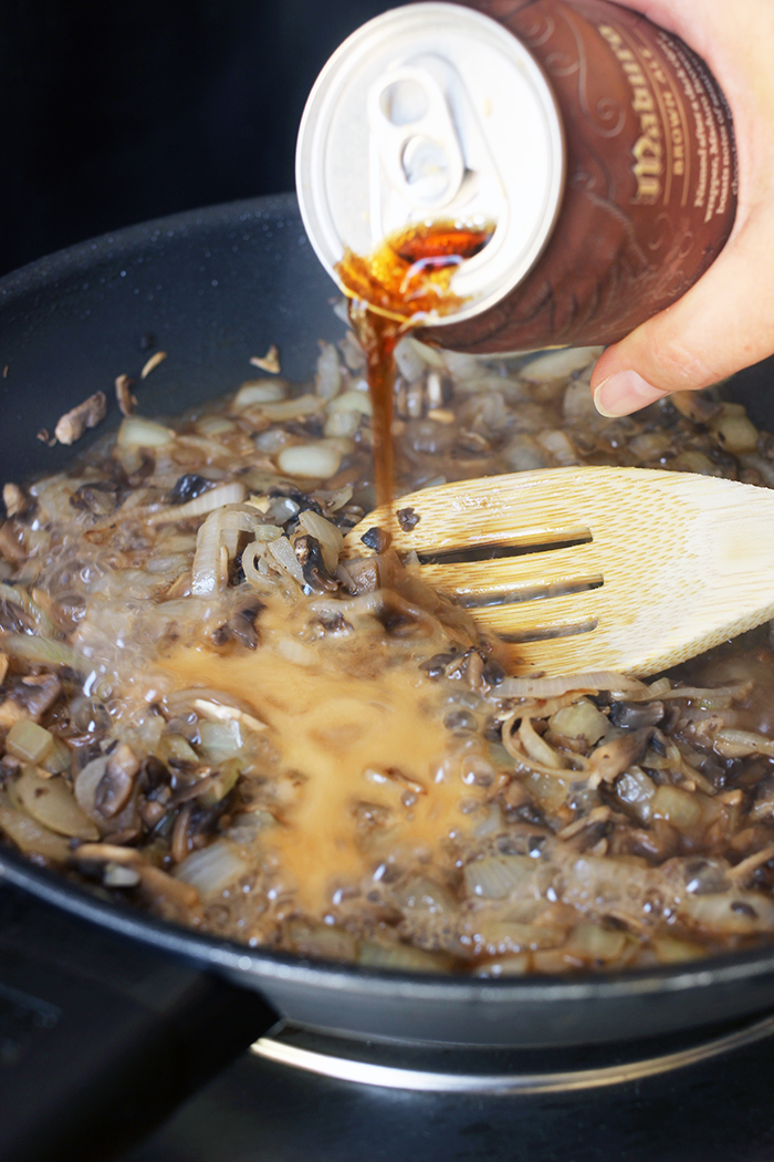 adding beer to skillet