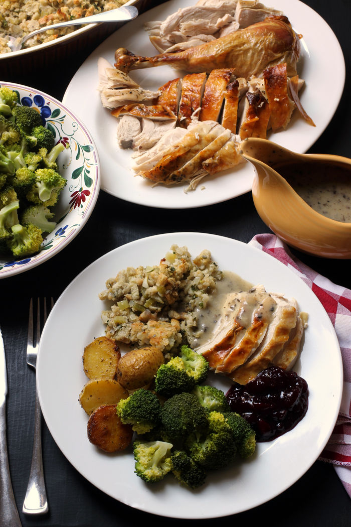 holiday dinner plate on table with dishes