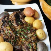 pot roast on platter with tri-color potatoes