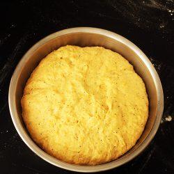 pumpkin roll dough risen in bowl