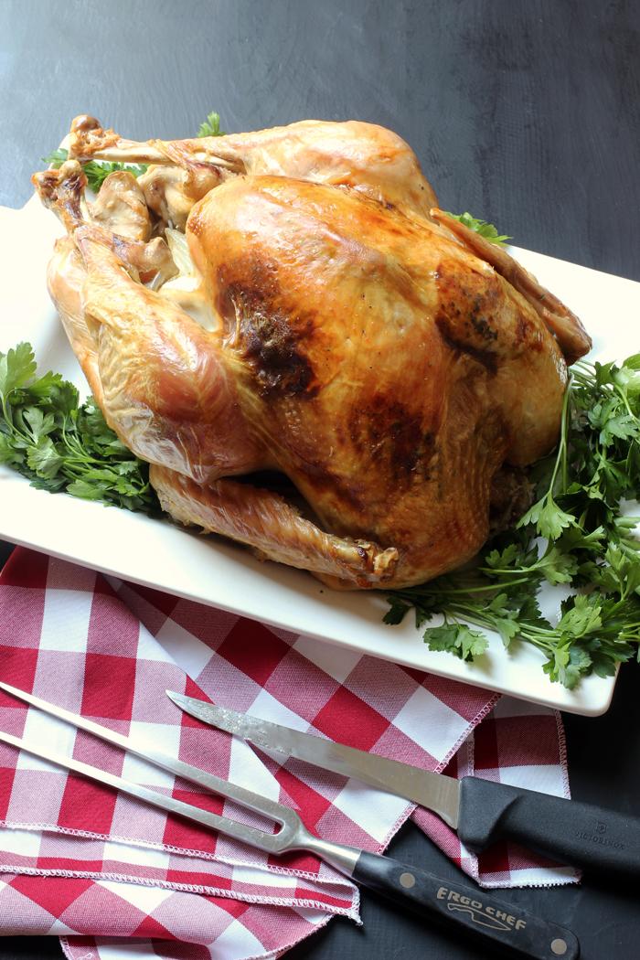 roast turkey next to carving utensils