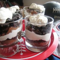 Mint chocolate cream parfaits on a red tray