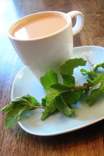 A close up of a cup of coffee, with Mint