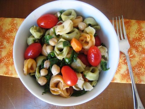 A bowl of tortellini pasta salad