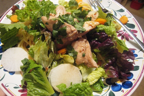 A plate of food on a table, with Salad