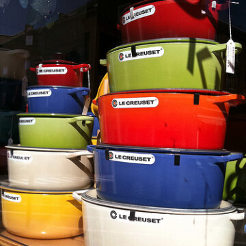 Le Creuset pots stacked in store window