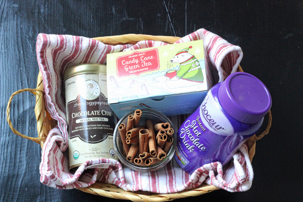 basket with tea, cinnamon sticks and hot cocoa