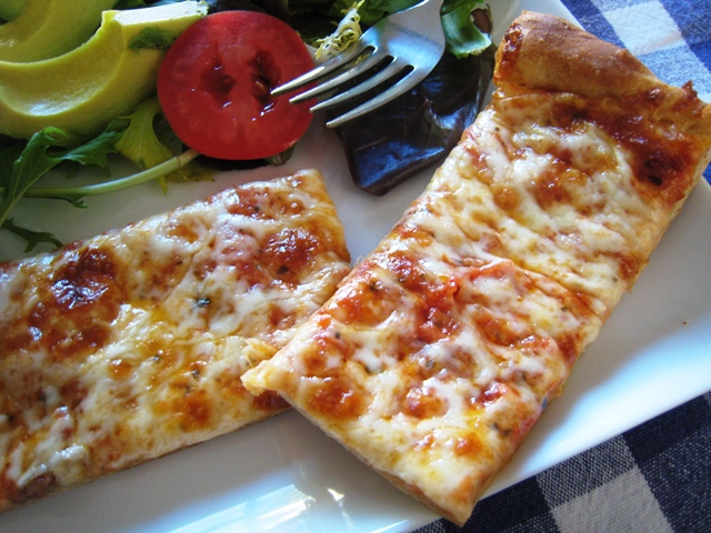 slices of cheese pizza on a plate