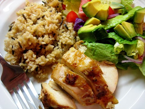 A plate of food with rice and vegetables, with Chicken