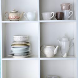 dishes collection in white cubbies