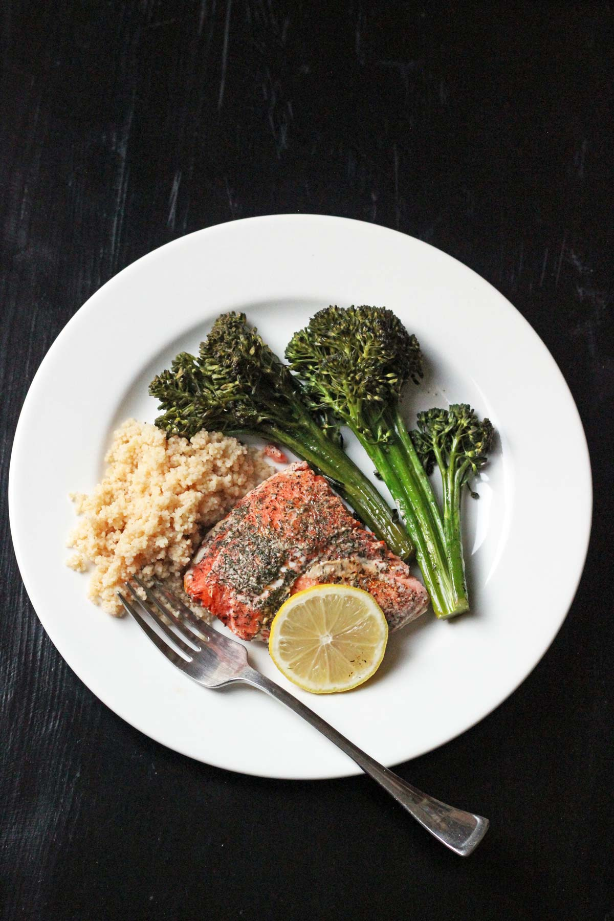 baked salmon and vegetables on a plate